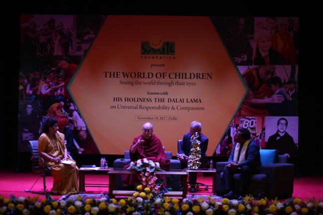 (R-L) Shantanu Mishra, Co-founder and Ex-trustee Smile Foundation, His Holiness The Dalai Lama and Rini Thomas, Former Doordarshan anchor